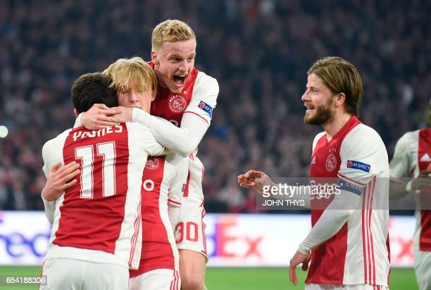 Ajax Amsterdam's forward Kasper Dolberg celebrates after scoring a penalty during the UEFA Europa League Round of 16 second leg football match Ajax...