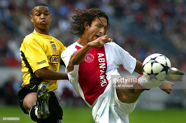 Ajax Amsterdam's forward Mido scores the equalizing 22 goal while being challenged by NAC Breda's Jurgen Collin during a Dutch soccer league match in...