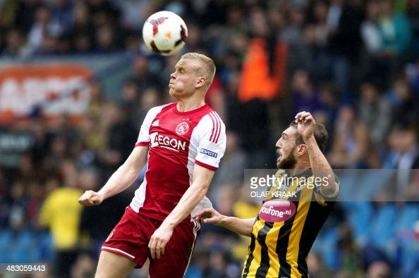 Ajax Amsterdam's player Kolbeinn Sigthorsson vies for the ball with Vitesse Arnehem player Guram Kashia during the Dutch Eredivisie soccer match...