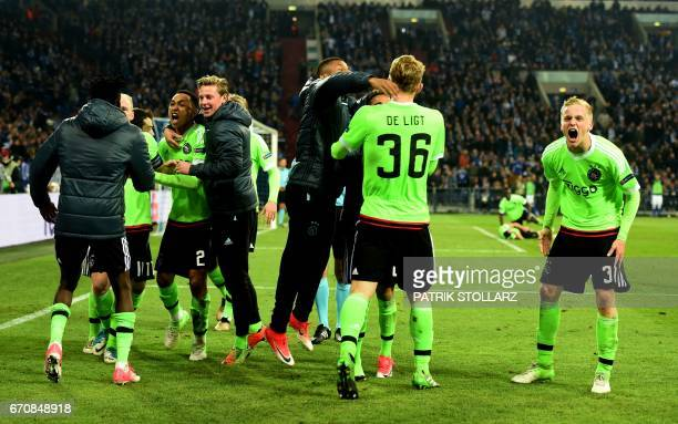 Ajax Amsterdam's players celebrate scoring during the UEFA Europa League 2ndleg quarterfinal football match between Schalke 04 and Ajax Amsterdam in...