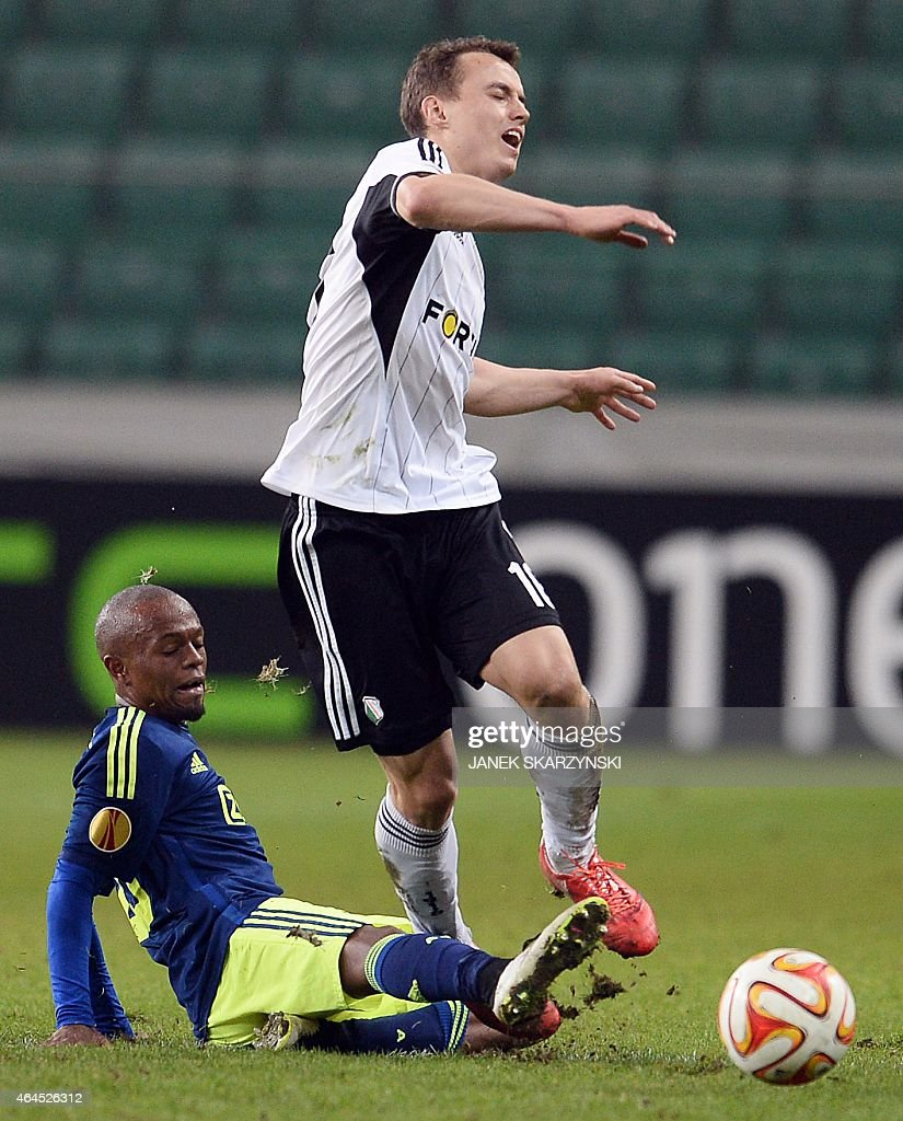 Ajax Amsterdam's South African midfielder <a gi-track='captionPersonalityLinkClicked' href=/galleries/search?phrase=Thulani+Serero&family=editorial&specificpeople=6234374 ng-click='$event.stopPropagation()'>Thulani Serero</a> (L) and Legia Warszawa's Michal Maslowski vie for the ball during the round of 32, second leg UEFA Europe League football match Legia Warszawa vs AFC Ajax Amsterdam, in Warsaw, on February 26, 2015.