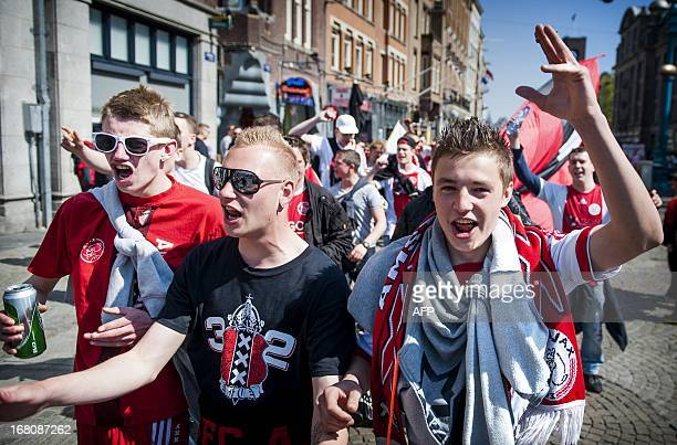 Ajax Amsterdam's supporters celebrate in a street in Amsterdam after their team won a Dutch Eredivisie football match against Willem II Tilburg at...