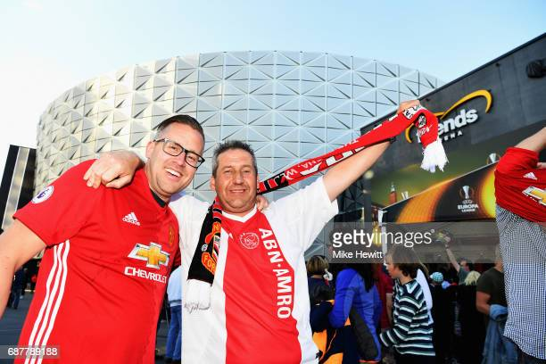 Ajax and Manchester United fan pose for a photo outside the stadium prior to the UEFA Europa League Final between Ajax and Manchester United at...