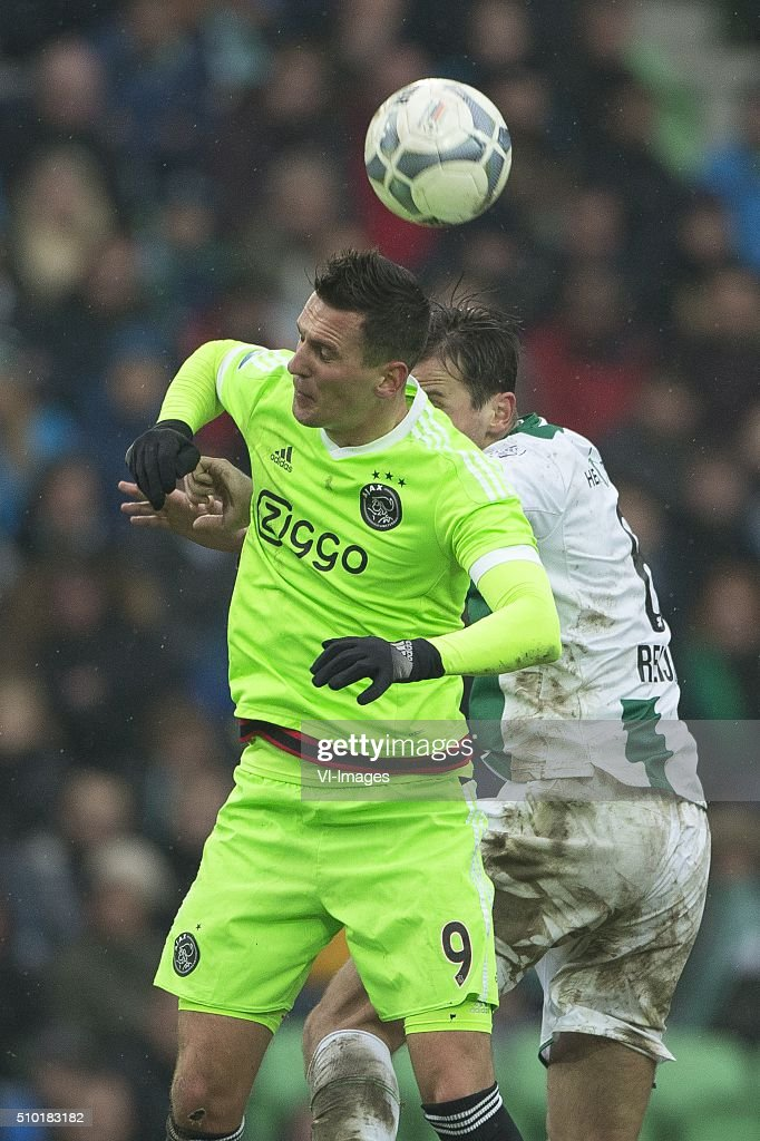 , Ajax, Arek Milik of AFC Ajax, Etinne Reijnen of FC Groningen, during the Dutch Eredivisie match between FC Groningen and Ajax Amsterdam at Euroborg on February 14, 2016 in Groningen, The Netherlands