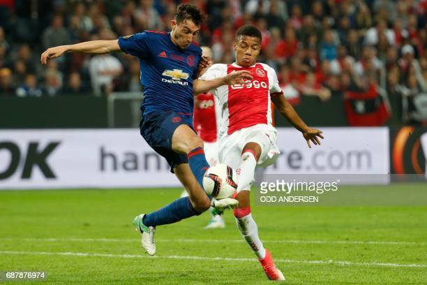 Ajax Brazilian forward David Neres and Manchester United's Italian defender Matteo Darmian vie for the ball during the UEFA Europa League final...