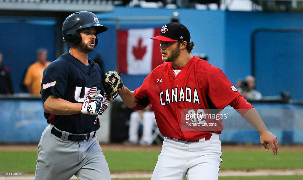 Ajax Canada July 17 2015 Canada's pitcher Shane Dawson tags out American Andrew Parrino en route to first base in the 5th Canada played the United...