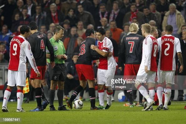 Ajax captain Luis Suarez was not sent off the pitch but later has accepted a sevenmatch ban for biting PSV Eindhoven midfielder Otman Bakkal's...