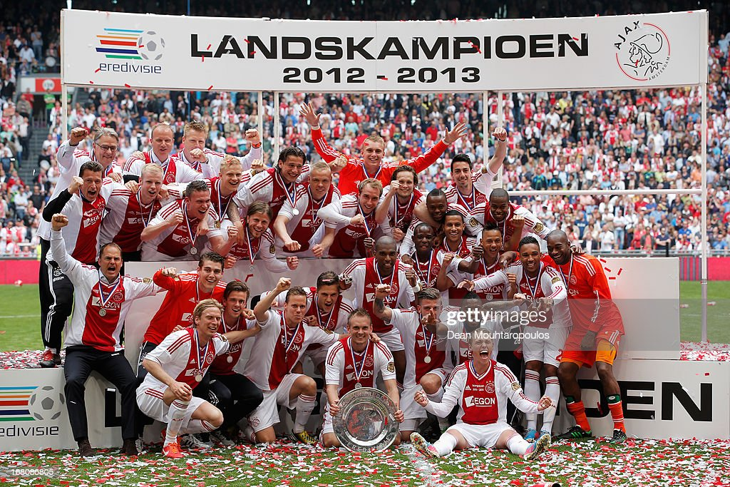 Ajax captain, Siem De Jong leads his teams celebrations with the Eredivisie Championship trophy after the match between Ajax and Willem II Tilburg at Amsterdam Arena on May 5, 2013 in Amsterdam, Netherlands.