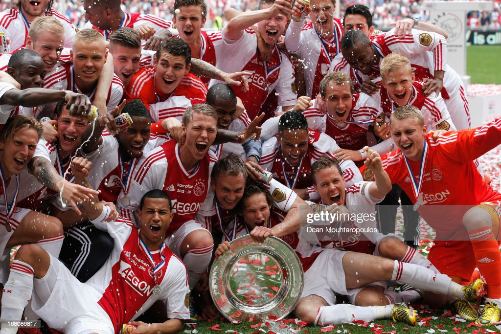 Ajax captain Siem De Jong leads his teams celebrations with the Eredivisie Championship trophy after the match between Ajax and Willem II Tilburg at...