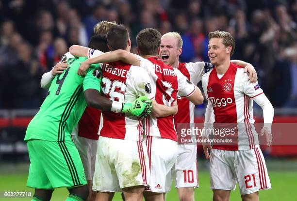 Ajax celebrate after the full time whistle in the UEFA Europa League quarter final first leg match between Ajax Amsterdam and FC Schalke 04 at...