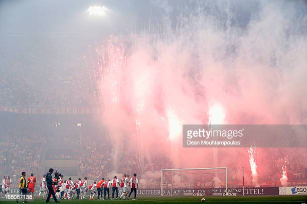 Ajax celebrate winning the Eredivisie Championship trophy after the match between Ajax and Willem II Tilburg in front of their fans as fireworks...