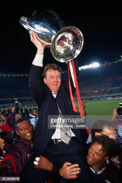 Ajax coach Louis van Gaal holding the trophy after Ajax won the 19941995 UEFA Champions League final against AC Milan 10