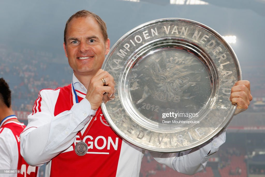 Ajax Coach / Manager, Frank de Boer poses with the Eredivisie Championship trophy after the match between Ajax and Willem II Tilburg at Amsterdam Arena on May 5, 2013 in Amsterdam, Netherlands.