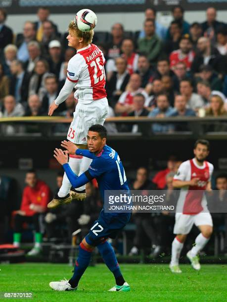 Ajax Danish forward Kasper Dolberg and Manchester United's English defender Chris Smalling vie for the ball during the UEFA Europa League final...