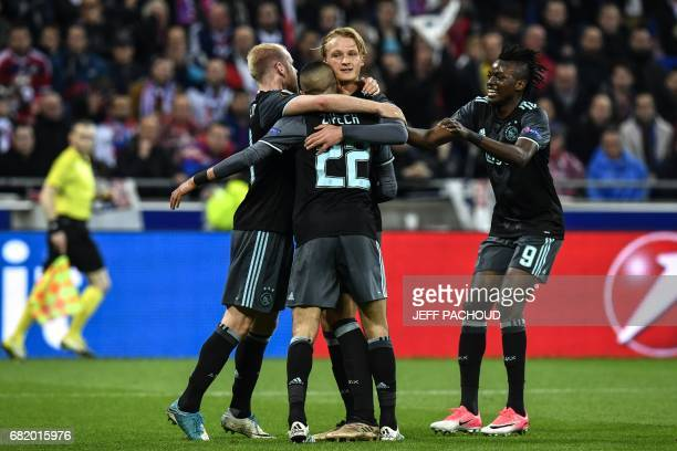 Ajax' Danish forward Kasper Dolberg celebrates with his teammates after scoring a goal during the Europa League semi final football match Olympique...