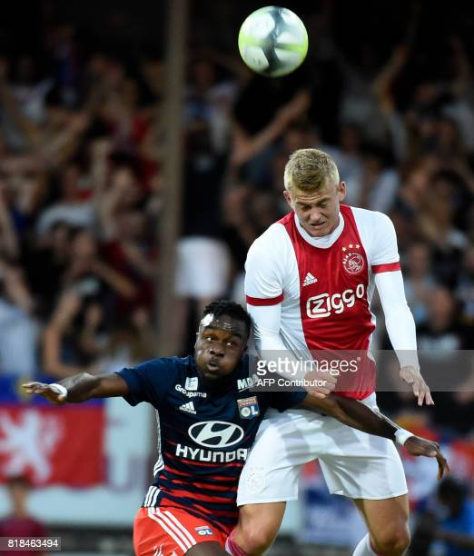 Ajax defender Matthijs de Ligt and Lyon's French forward Maxwel Cornet go for a header during a friendly football match between Olympique Lyonnais...