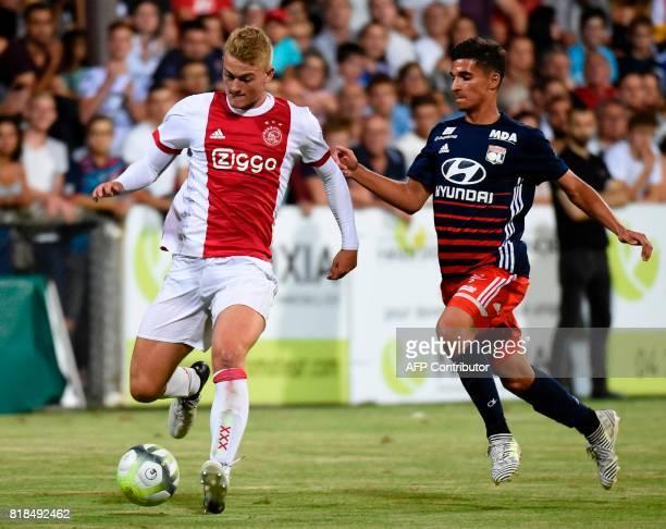 Ajax defender Matthijs de Ligt outruns Lyon's French midfielder Houssem Aouar during a friendly football match between Olympique Lyonnais and Ajax...