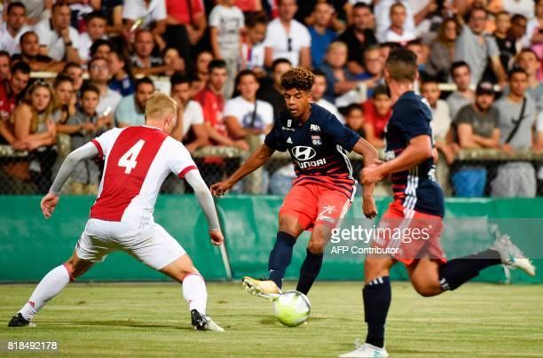 Ajax defender Matthijs de Ligt vies with Lyon's forward Willem Geubbels during a friendly football match between Olympique Lyonnais and Ajax...