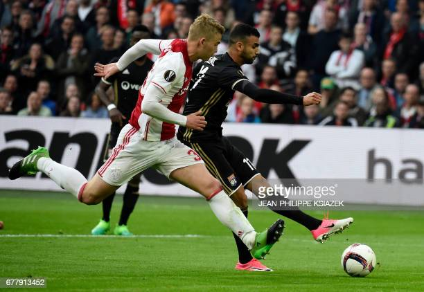 Ajax defender Matthijs de Ligt vies with Lyon's French Algerian midfielder Rachid Ghezzal vie during UEFA Europa League semifinal first leg Ajax...