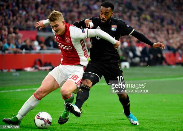 Ajax defender Matthijs de Ligt vies with Lyon's French forward Alexandre Lacazette during UEFA Europa League semifinal first leg Ajax Amsterdam v...