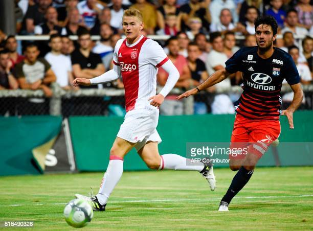 Ajax defender Matthijs de Ligt vies with Lyon's French midfielder Clement Grenier during a friendly football match between Olympique Lyonnais and...