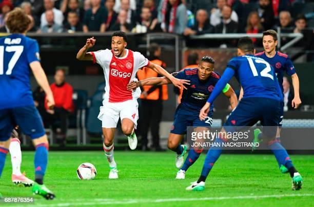 Ajax Dutch defender Jairo Riedewald and Manchester United's Ecuadorian midfielder Antonio Valencia vie for the ball during the UEFA Europa League...