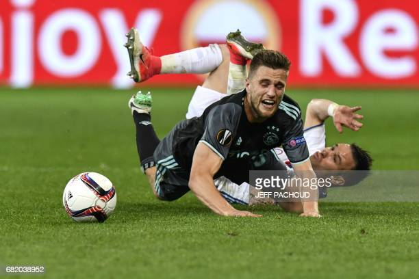 Ajax' Dutch defender Joel Veltman vies with Lyon's French forward Mathieu Valbuena during the Europa League semi final football match Olympique...
