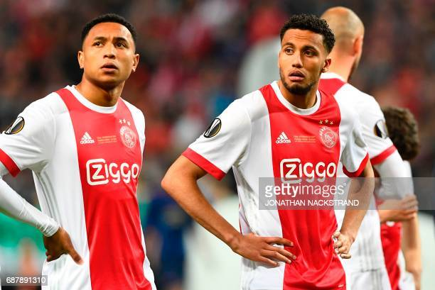 Ajax Dutch defender Kenny Tete and Ajax Dutch defender Jairo Riedewald react after the UEFA Europa League final football match Ajax Amsterdam v...