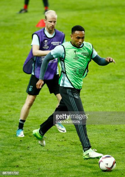 Ajax Dutch defender Kenny Tete controls the ball as he and his teammates take part in a training session at the Friends Arena in Solna outside...