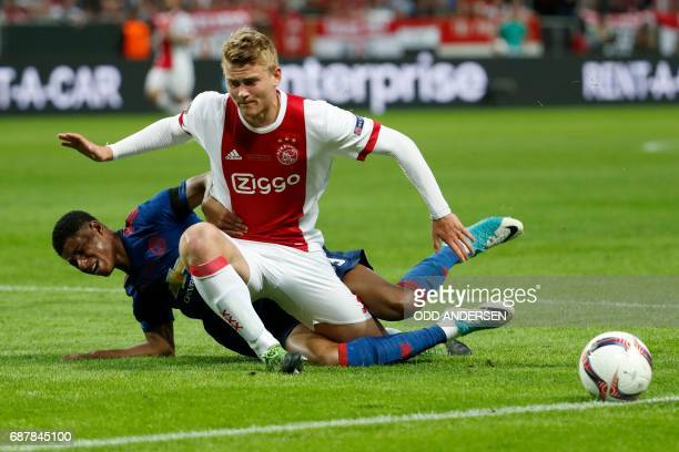 Ajax Dutch defender Matthijs de Ligt and Manchester United's English striker Marcus Rashford vie for the ball during the UEFA Europa League final...