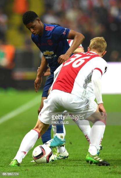 Ajax Dutch defender Matthijs de Ligt vies for the ball with Manchester United's English striker Marcus Rashford during the UEFA Europa League final...