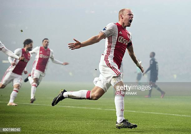 Ajax' Dutch midfielder Davy Klaassen celebrates after scoring a goal during the Dutch League football match between AFC Ajax and PSV Eindhoven in...