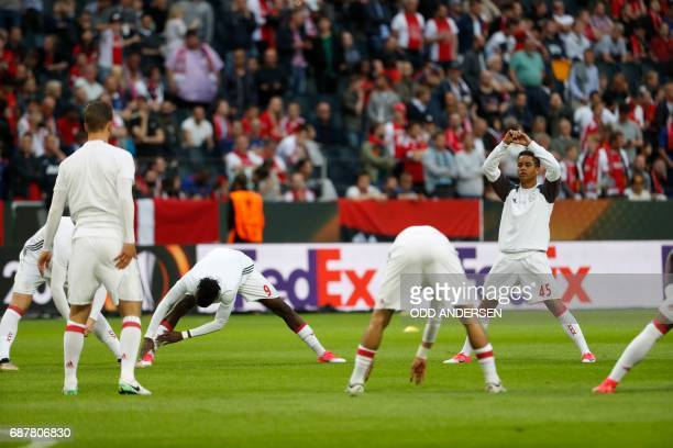 Ajax Dutch players including Ajax Dutch forward Justin Kluivert during warm up prior to the UEFA Europa League final football match Ajax Amsterdam v...