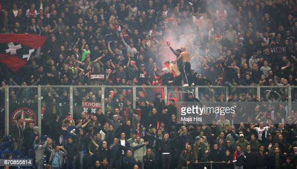 Ajax fans celebrate during the UEFA Europa League quarter final second leg match between FC Schalke 04 and Ajax Amsterdam at VeltinsArena on April 20...
