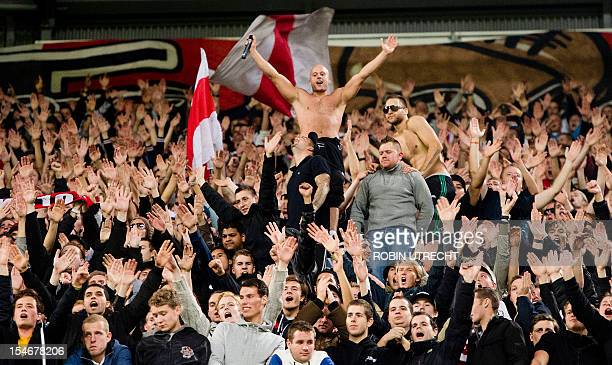 Ajax' fans celebrate their team's 31 win during the UEFA Champions League group D football match Ajax Amsterdam vs Manchester City on October 24 at...