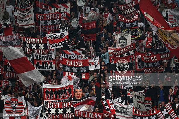 Ajax fans cheer and wave flags during the Eredivisie match between Ajax Amsterdam and VVV Venlo at Amsterdam Arena on May 2 2012 in Amsterdam...