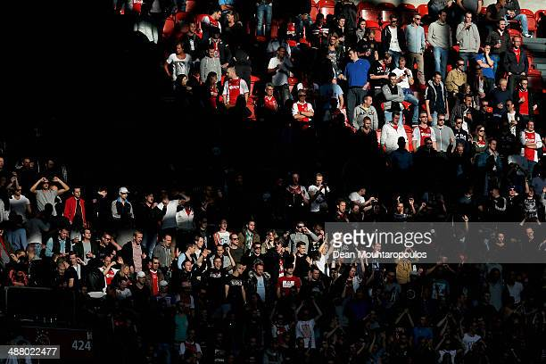 Ajax fans cheer during the Eredivisie match between Ajax Amsterdam and NEC Nijmegen at Amsterdam Arena on May 3 2014 in Amsterdam Netherlands