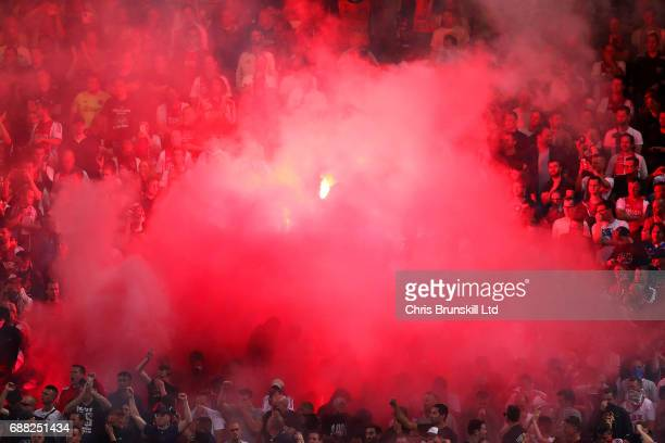 Ajax fans display a flare during the UEFA Europa League Final match between Ajax and Manchester United at Friends Arena on May 24 2017 in Stockholm...