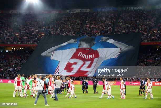 Ajax fans display a giant banner in support of Abdelhak Nouri of Ajax before the UEFA Champions League Qualifying Third Round match between Ajax and...