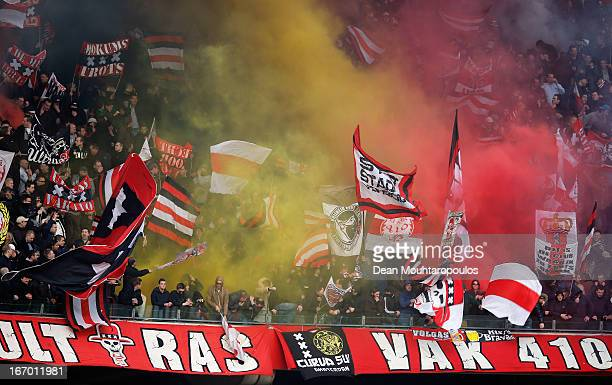 Ajax fans release flares and smoke bombs prior to the Eredivisie match between Ajax Amsterdam and SC Heerenveen at Amsterdam Arena on April 19 2013...