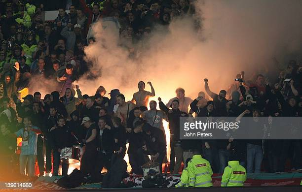 Ajax fans watch from the stand during the UEFA Europa League round of 32 second leg match at Old Trafford on February 23 2012 in Manchester England