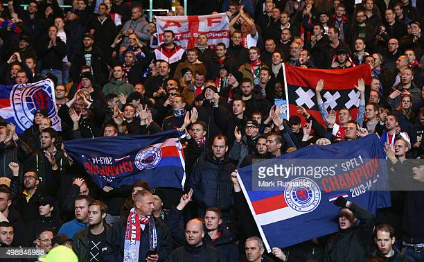 Ajax fans waves Glasgow Rangers flags prior to the UEFA Europa League Group A match between Celtic FC and AFC Ajax at Celtic Park on November 26 2015...
