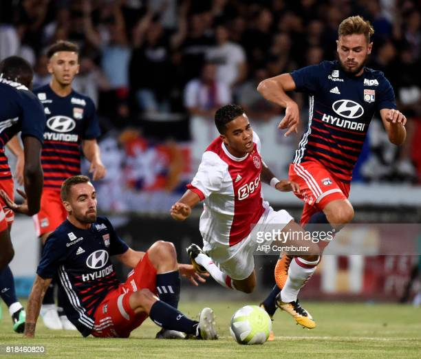 Ajax forward Justin Kluivert vies with Lyon's French midfielder Lucas Tousart during a friendly football match between Olympique Lyonnais and Ajax...