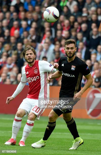 Ajax forward Lasse Schöne vies with Lyon's French midfielder Lucas Tousart during UEFA Europa League semifinal first leg Ajax Amsterdam v Olympique...