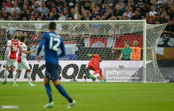 Ajax goalkeeper Andre Onana attempts to save Paul Pogba's deflected shot as Manchester United score their first goal during the UEFA Europa League...