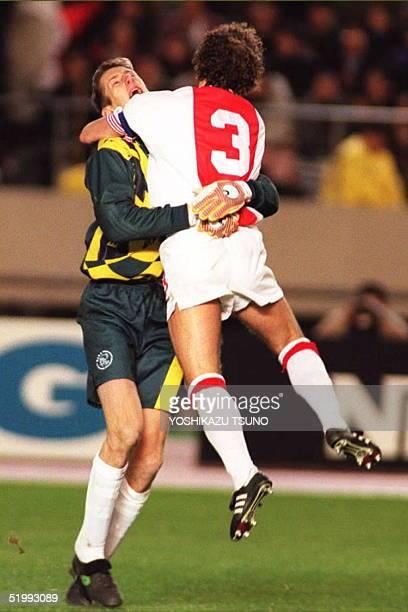 Ajax goalkeeper Edwin van der Sar hugs his team captain Danny Blind after Blind scored the goal in the last penalty shootout to defeat Brazilian...
