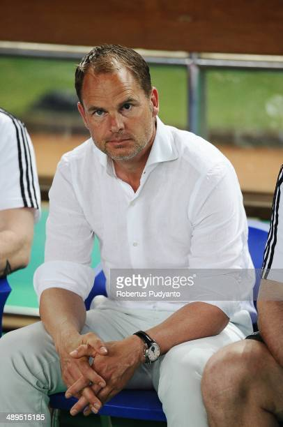 Ajax head coach Frank De Boer sits on the bench during the international friendly match between Perija Jakarta and AFC Ajax on May 11 2014 in Jakarta...