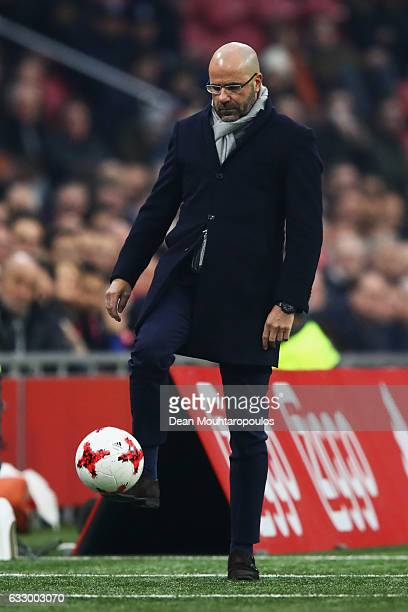 Ajax Head Coach / Manager Peter Bosz lcontrols the ball during the Eredivisie match between Ajax Amsterdam and ADO Den Haag held at Amsterdam Arena...