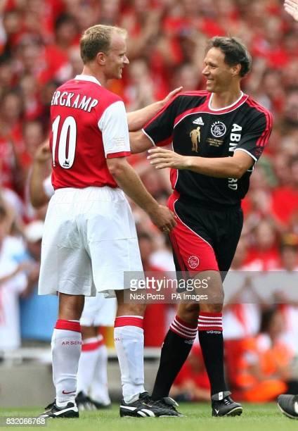 Ajax Holland legend Marco Van Basten with Arsenal's Dennis Begkamp during his Testimonial match at Emirates Stadium London