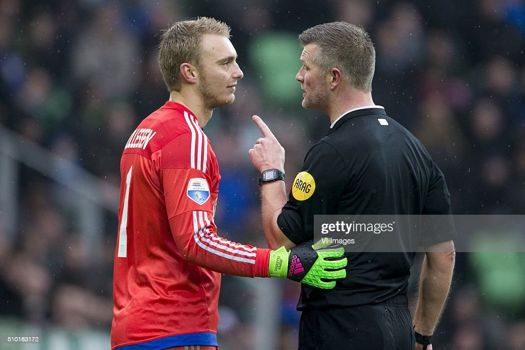 , Ajax, Keeper Jasper Cillessen of AFC Ajax, scheidsrechter Richard Liesveld, during the Dutch Eredivisie match between FC Groningen and Ajax Amsterdam at Euroborg on February 14, 2016 in Groningen, The Netherlands